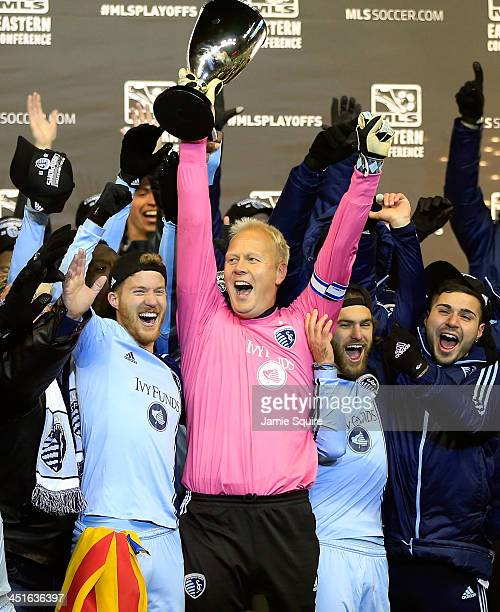 Captain Jimmy Nielsen of the Sporting KC hoists the trophy with teammates after Sporting KC defeated the Houston Dynamo to win the Eastern Conference...