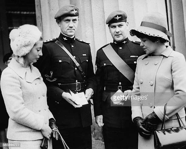 Captain John Ridgway and Sergeant Charles Blyth holding their investitures with their wives at Buckingham Palace London November 23rd 1967