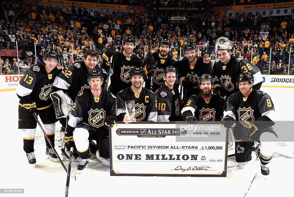 Captain John Scott #28 of the Arizona Coyotes and the rest of his Pacific Division All-Stars teammates of the Western Conference pose with the one million dollar winner's check after defeating the Atlantic Division All-Stars of the Eastern Conference in the 2016 Honda NHL All-Star Final Game at Bridgestone Arena on January 31, 2016 in Nashville, Tennessee. The Pacific Divisoin All-Stars of the Western Conference defeated the Atlantic Division All-Stars of the Eastern Conference 1-0.