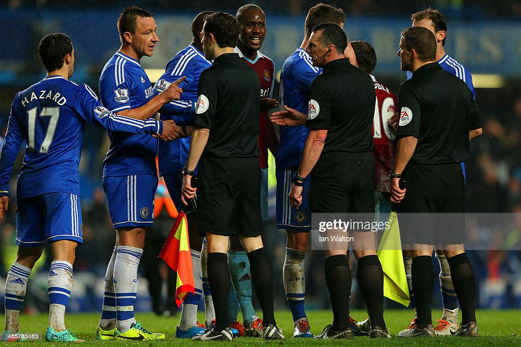 Captain <a gi-track='captionPersonalityLinkClicked' href=/galleries/search?phrase=John+Terry&family=editorial&specificpeople=171535 ng-click='$event.stopPropagation()'>John Terry</a> has words with Referee Neil Swarbrick during the Barclays Premier League match between Chelsea and West Ham United at Stamford Bridge on January 29, 2014 in London, England.