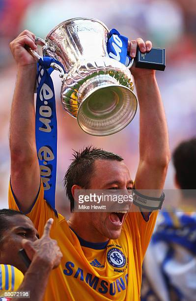Captain John Terry of Chelsea celebrates with the trophy following victory during the FA Cup sponsored by EON Final match between Chelsea and Everton...