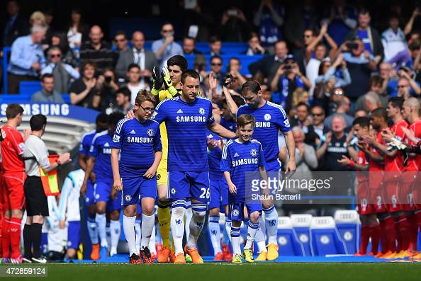 Captain John Terry of Chelsea leads out his team through a guard of honour by the Liverpool players during the Barclays Premier League match between...
