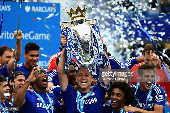 Captain John Terry of Chelsea lifts the trophy after the Barclays Premier League match between Chelsea and Sunderland at Stamford Bridge on May 24...
