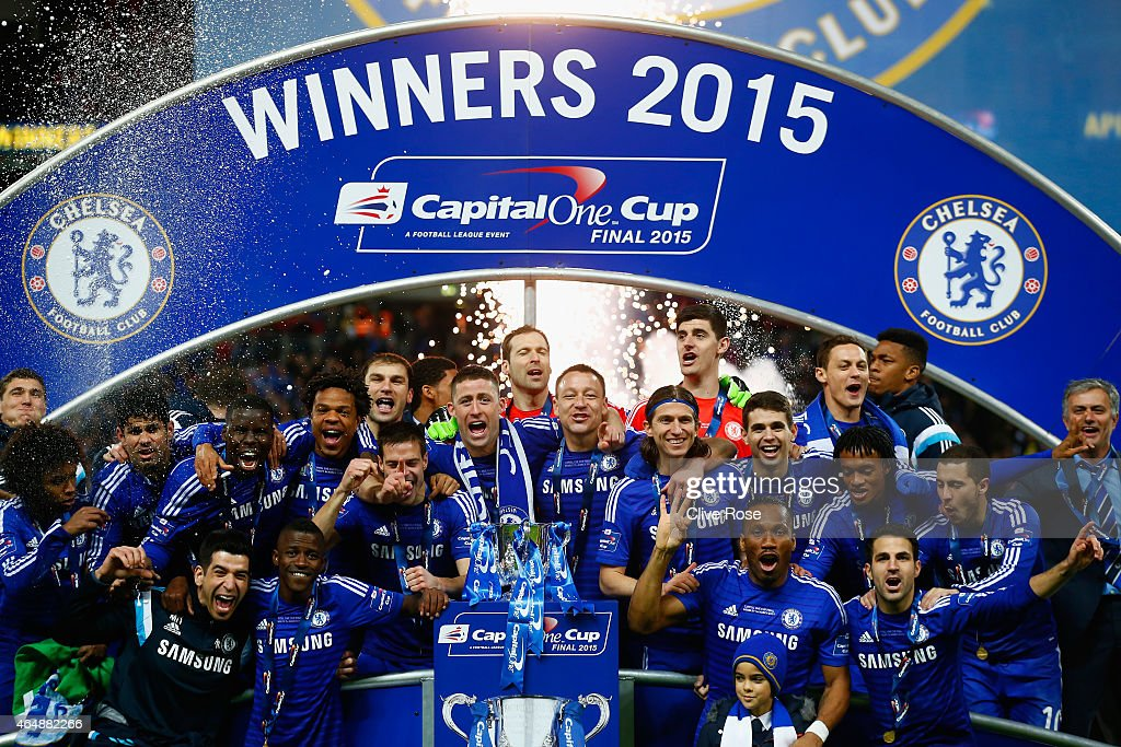 Captain <a gi-track='captionPersonalityLinkClicked' href=/galleries/search?phrase=John+Terry&family=editorial&specificpeople=171535 ng-click='$event.stopPropagation()'>John Terry</a> of Chelsea poses with team mates and the trophy during the Capital One Cup Final match between Chelsea and Tottenham Hotspur at Wembley Stadium on March 1, 2015 in London, England.