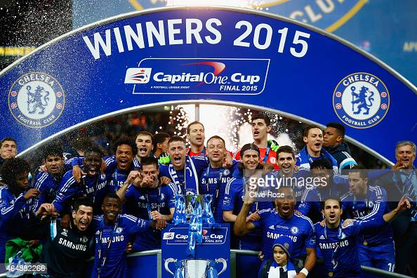 Captain John Terry of Chelsea poses with team mates and the trophy during the Capital One Cup Final match between Chelsea and Tottenham Hotspur at...