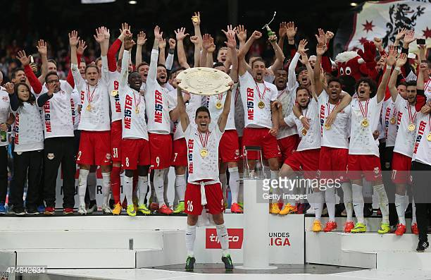 Captain Jonatan Soriano of Salzburg celebrates with his team and the trophy for winning the Austrian Soccer Championship after the tipico Bundesliga...