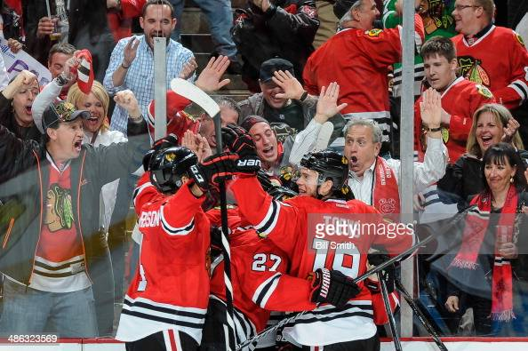 Captain Jonathan Toews of the Chicago Blackhawks celebrates with his teammates after the Blackhawks scored against the St Louis Blues in the second...