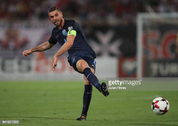 Captain Jordan Henderson of England passes the ball during the FIFA 2018 World Cup Qualifier between Malta and England at Ta'Qali National Stadium on...