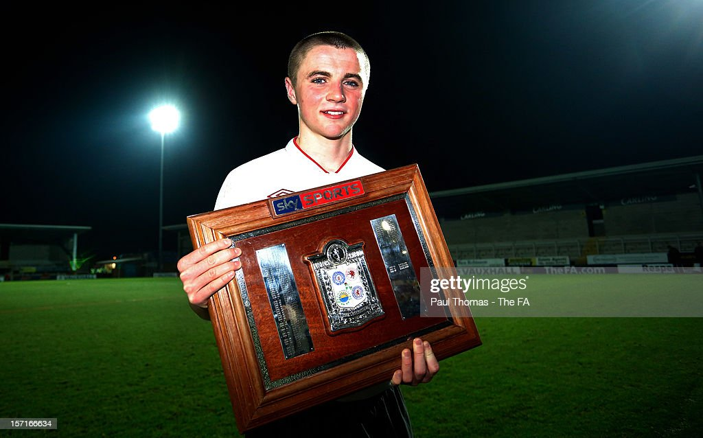 Captain <a gi-track='captionPersonalityLinkClicked' href=/galleries/search?phrase=Jordan+Rossiter&family=editorial&specificpeople=8574887 ng-click='$event.stopPropagation()'>Jordan Rossiter</a> of England U16 poses with the trophy after the Sky Sports Victory Shield match between England U16 and Scotland U16 at Pirelli Stadium on November 29, 2012 in Burton-upon-Trent, England.