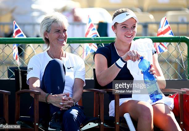 Captain Judy Murray and Katie Swan of Great Britain look on inbetween games in her match against Ilze Hattingh of South Africa during the tie between...