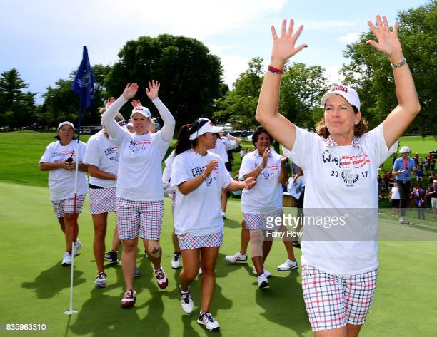 Captain Juli Inkster of Team USA celebrates a 16 1/2 to 11 1/2 win over Team Europe on the 17th green during the final day singles matches of the...