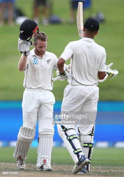 Captain Kane Williamson is congratulated by Jeet Raval of New Zealand on scoring 100 runs during day three of the Test match between New Zealand and...