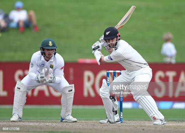 Captain Kane Williamson of New Zealand bats watched by Wicketkeeper Quinton de Kock of South Africa during day three of the Test match between New...