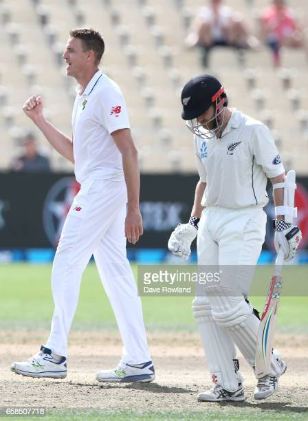 Captain Kane Williamson of New Zealand leaves the field having been caught by Vernon Philander and bowled by Morne Morkel of South Africa for 176...