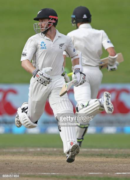 Captain Kane Williamson of New Zealand makes a run with Mitchell Santner during day four of the Test match between New Zealand and South Africa at...