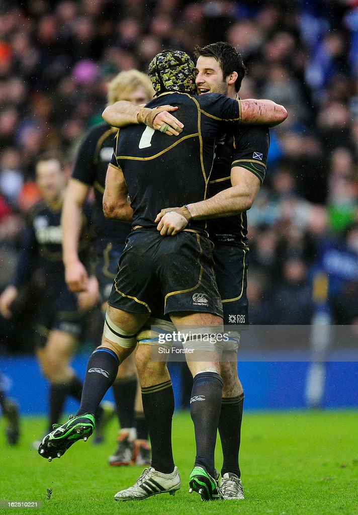 Captain Kelly Brown (L) of Scotland celebrates his team's victory with teammate Johnnie Beattie during the RBS Six Nations match between Scotland and Ireland at Murrayfield Stadium on February 24, 2013 in Edinburgh, Scotland.