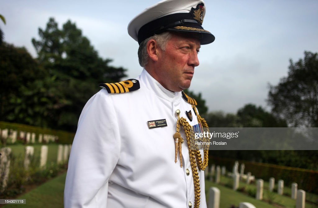 Captain Ken Taylor from the British Royal Navy attends the burial of eight RAF crew members at the Commonwealth War Cemetery on October 18, 2012 in Kuala Lumpur, Malaysia. The eight crew members were flying a B-24 Liberator on August 23, 1945, eight days after Japan surrendered in World War II, when the plane crashed and was lost near Kuala Pilah, Malaysia. The crash site was undiscovered until the 1990s and human remains were found in 2009 after a detailed investigation.