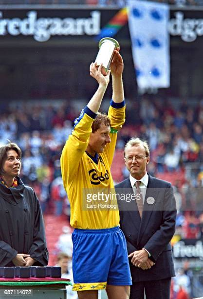Captain Kim Vilfort of Brondby IF with the trophy as cup winners after the Danish Cup Final Compaq Cup match between FC Copenhagen and Brondby IF at...