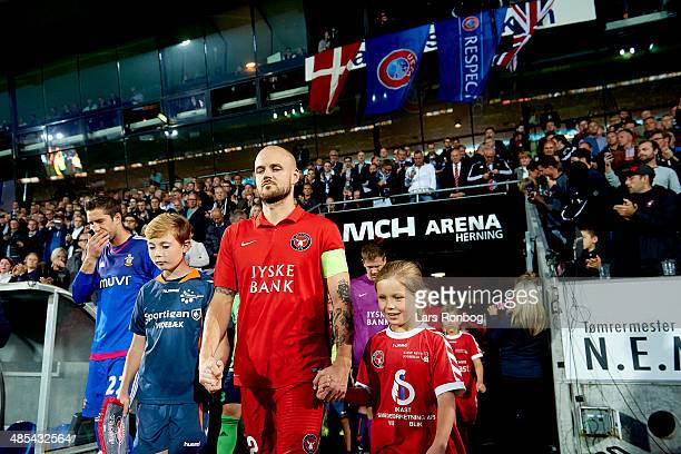 Captain Kristian Bach Bak of Midtjylland leads his team on to the pitch prior to the UEFA Europa League match between FC Midtjylland and Southampton...