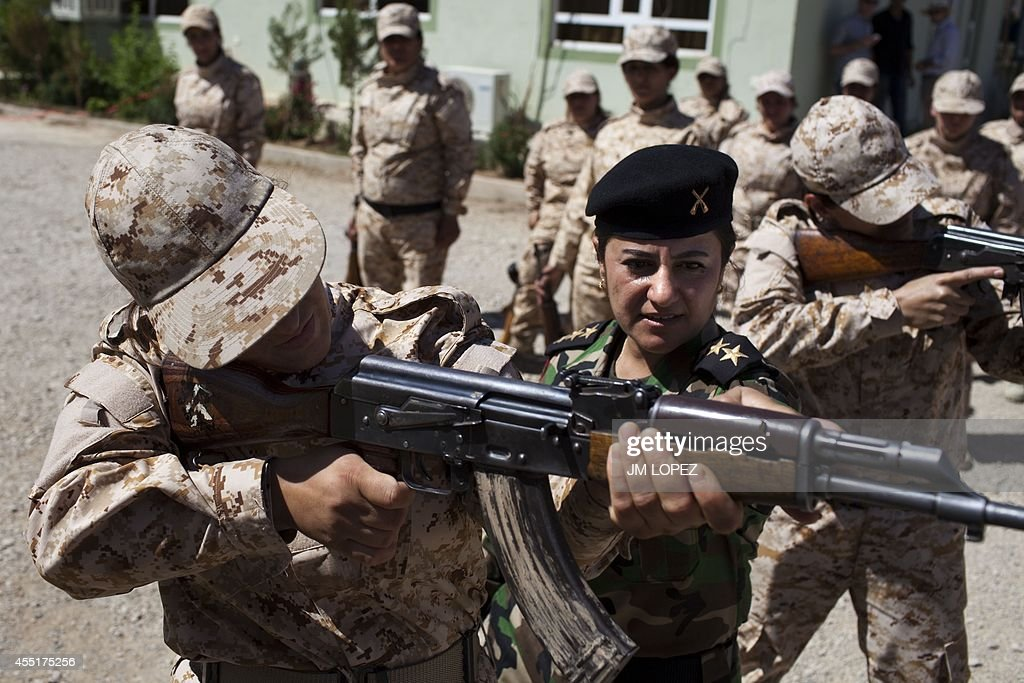Captain Kwestan Mohammed Ali instructs how to hold an AK47 to women Peshmerga recruits some of whom are volunteers as they take part in a military...