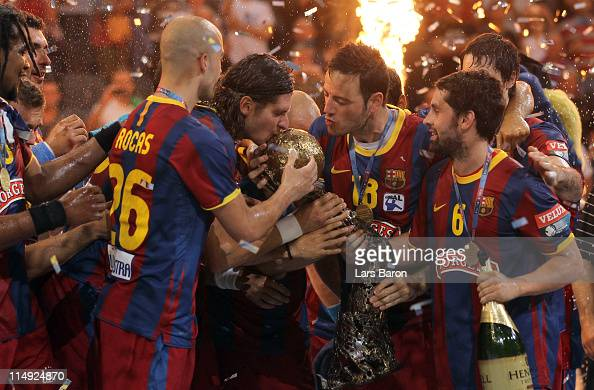 Captain Laszlo Nagy of Barcelona and team mate Iker Romero kiss the trophy after winning the EHF Final Four final match between FC Barcelona Borges...