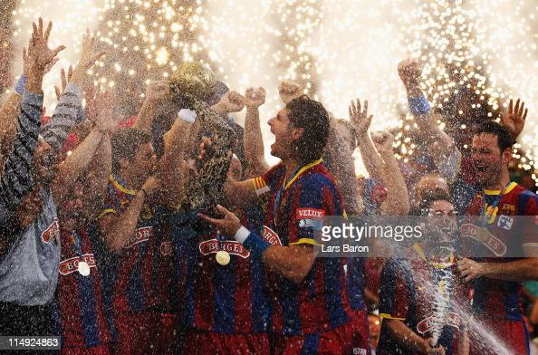 Captain Laszlo Nagy of Barcelona lifts the trophy after winning the EHF Final Four final match between FC Barcelona Borges and Ciudad Real at Lanxess...