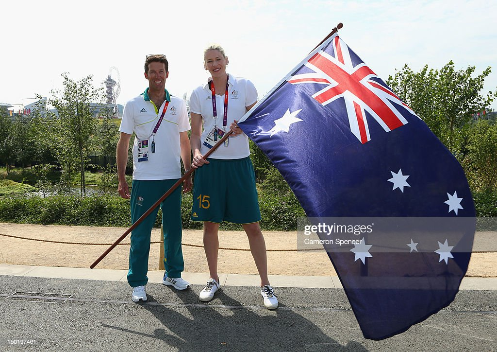 Captain <a gi-track='captionPersonalityLinkClicked' href=/galleries/search?phrase=Lauren+Jackson&family=editorial&specificpeople=201699 ng-click='$event.stopPropagation()'>Lauren Jackson</a> of the Australian Women's basketball team poses with closing ceremony flag bearer, gold medallist sailor <a gi-track='captionPersonalityLinkClicked' href=/galleries/search?phrase=Malcolm+Page&family=editorial&specificpeople=4403554 ng-click='$event.stopPropagation()'>Malcolm Page</a> (L) during an Australian flag handover at the Olympic Park Common Domain on Day 16 of the London 2012 Olympic Games in the Olympic Park on August 12, 2012 in London, England.