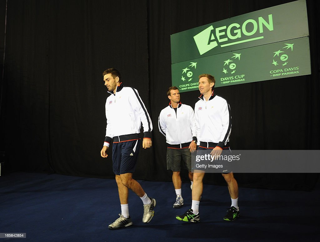 Captain Leon Smith with Colin Flemming and Jonny Marray of Great Britain before the enter the court during day two of the Davis Cup match between Great Britain and Russia at Ricoh Arena on April 6, 2013 in Coventry, England.