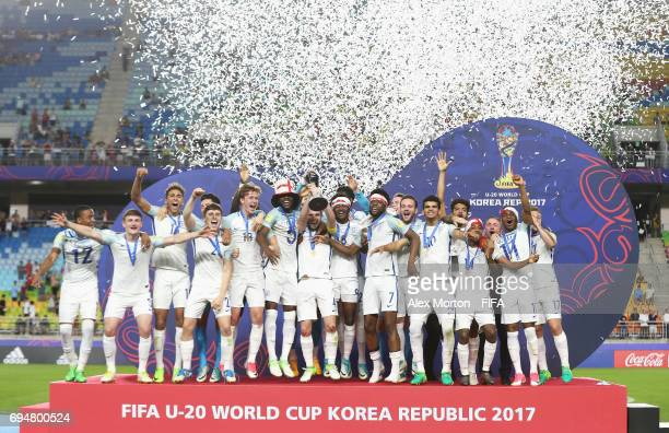 Captain Lewis Cook of England lifts the trophy in victory with team mates after the FIFA U20 World Cup Korea Republic 2017 Final between Venezuela...