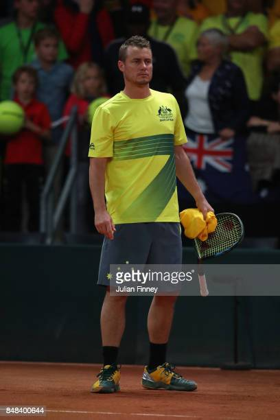 Captain Lleyton Hewitt holds the broken racket of Nick Kyrgios of Australia after his loss to David Goffin of Belgium during day three of the Davis...