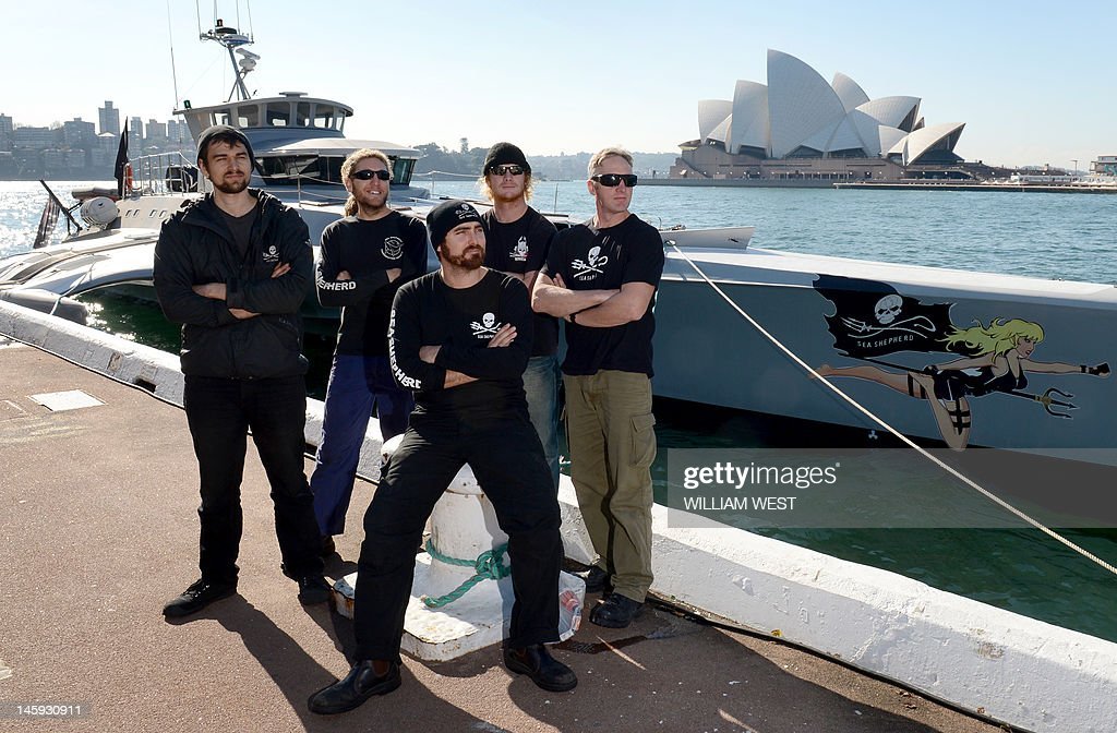 Captain Locky MacLean (C) of the Sea Shepherd ship 'Brigitte Bardot' and his crew take in the sights after the ship docked at Sydney's Circular Quay on June 8, 2012, after campaigning against the Japanese whaling fleet in the Southern Ocean. The Brigitte Bardot will take on vital supplies before heading across the Coral Sea to seek out illegal shark finning operations in the Pacific. AFP PHOTO/William WEST