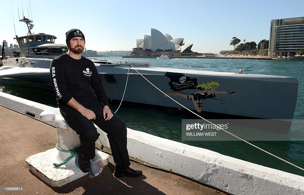 Captain Locky MacLean of the Sea Shepherd ship 'Brigitte Bardot' takes in the sights after the ship docked at Sydney's Circular Quay on June 8, 2012, after its campaign against the Japanese whaling fleet in the Southern Ocean. The Brigitte Bardot will take on vital supplies before heading across the Coral Sea to seek out illegal shark finning operations in the Pacific. AFP PHOTO/William WEST
