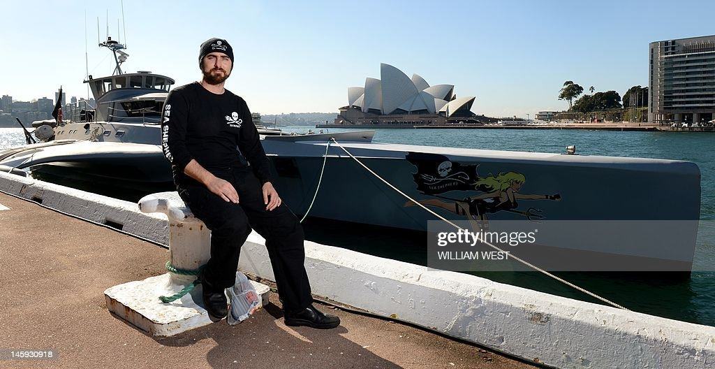 Captain Locky MacLean of the Sea Shepherd ship 'Brigitte Bardot' takes in the sights after the ship docked at Sydney's Circular Quay on June 8, 2012, after campaigning against the Japanese whaling fleet in the Southern Ocean. The Brigitte Bardot will take on vital supplies before heading across the Coral Sea to seek out illegal shark finning operations in the Pacific. AFP PHOTO/William WEST