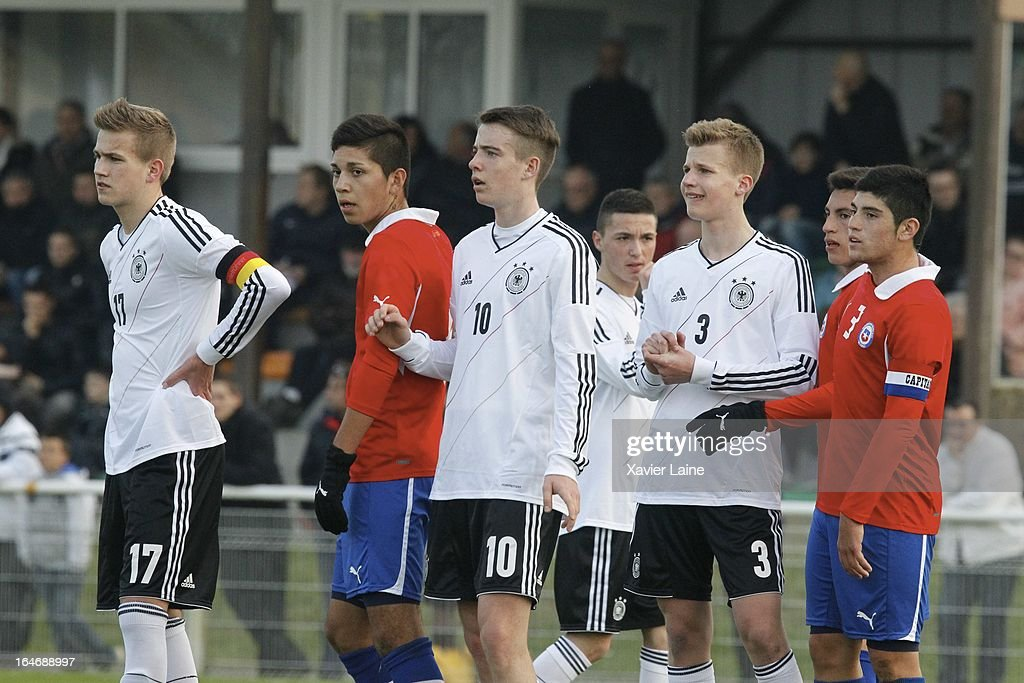 Captain Lukas Boeder, Max Besuschkow and Jonas Nickel of Germany during the International Friendly match between U16 Germany and U16 Chile on March 26, 2013 in La Roche-sur-Yon, France.