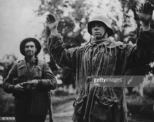 Captain M A Cardinal of the Canadian army with a captured German soldier near Carpiquet during World War II 1944 He is one of the first prisoners...