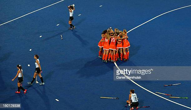 Captain Maartje Paumen of Netherlands celebrates with teammates after defeating Argentina 20 during the Women's Hockey gold medal match on Day 14 of...