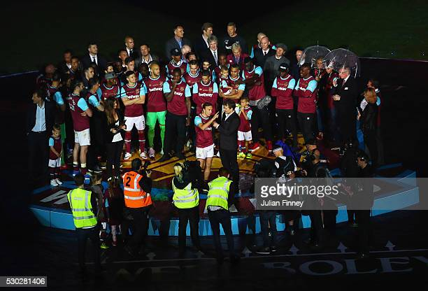 Captain Mark Noble is interviewed by Ben Shephard as the squad look on during the Barclays Premier League match between West Ham United and...