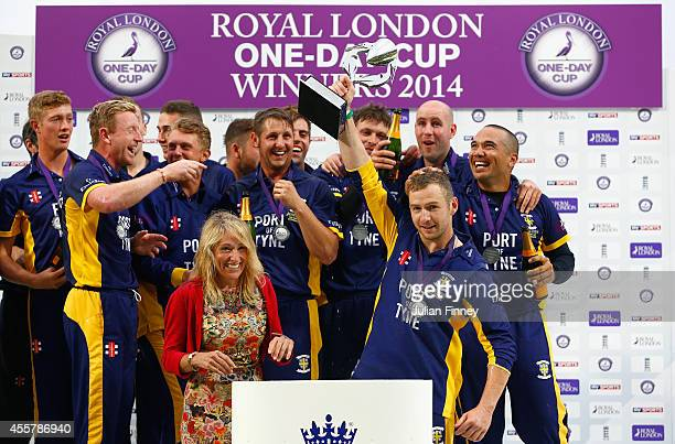 Captain Mark Stoneman lifts the trophy as they celebrate defeating Warwickshire in the final during the Royal London OneDay Cup 2014 Final at Lord's...