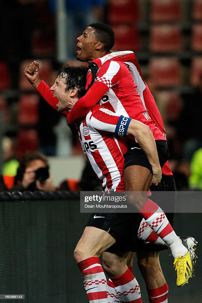 Captain, Mark Van Bommel (#6) of PSV celebrates scoring his teams second goal of the game with team mates during the KNVB Dutch Cup match between PSV Eindhoven and Feyenoord Rotterdam at Philips Stadion on January 30, 2013 in Eindhoven, Netherlands.