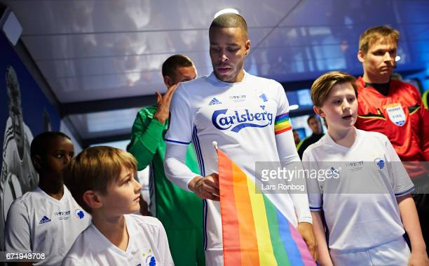 Captain Mathias Zanka Jorgensen of FC Copenhagen stands ready with the mascots in the players tunnel prior to the Danish Alka Superliga match between...