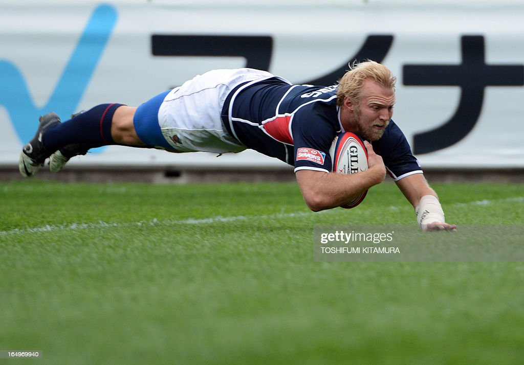 US captain Matt Hawkins dives to score a try during their rugby sevens world series, Tokyo Sevens 2013 match against Wales in Tokyo on March 30, 2013. US beat Wales 24-22.