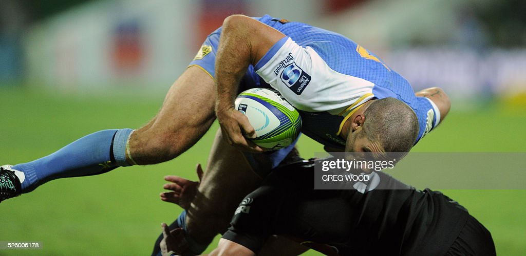 Captain Matt Hodgson (top) from Western Force attempts to break a tackle during the Super Rugby match between Australias Western Force and South Africas Bulls in Perth on April 29, 2016. / AFP / Greg Wood / --IMAGE