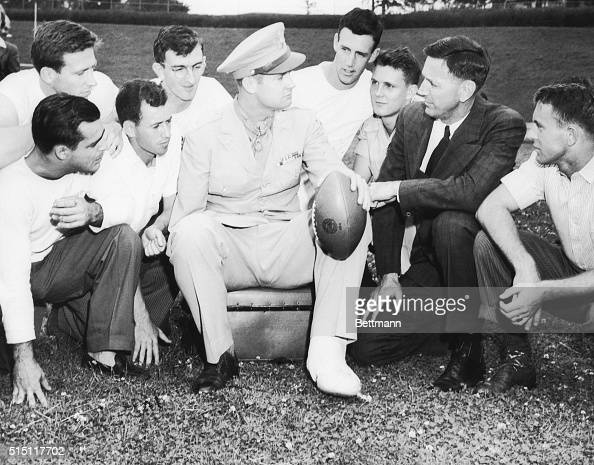 Captain Maurice L Britt who was recently awarded the Congressional Medal of Honor talks with Coach Glen Rose of Arkansas University and a group of...