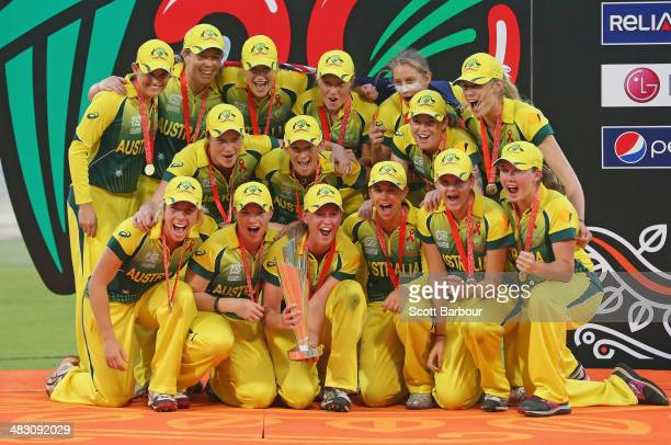 Captain Meg Lanning and the Australian team celebrate with the trophy on the podium after winning the Final of the ICC Women's World Twenty20...