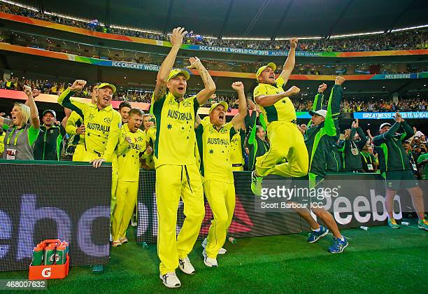 Captain Michael Clarke David Warner Aaron Finch coach Darren Lehmann and Australia celebrate after the winning runs were hit to win the 2015 ICC...