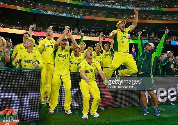 Captain Michael Clarke of Australia and his teammates celebrate after the winning runs were hit to win the 2015 ICC Cricket World Cup final match...