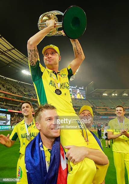 Captain Michael Clarke of Australia holds the World Cup trophy aloft as they celebrate after the winning runs were hit to win the 2015 ICC Cricket...