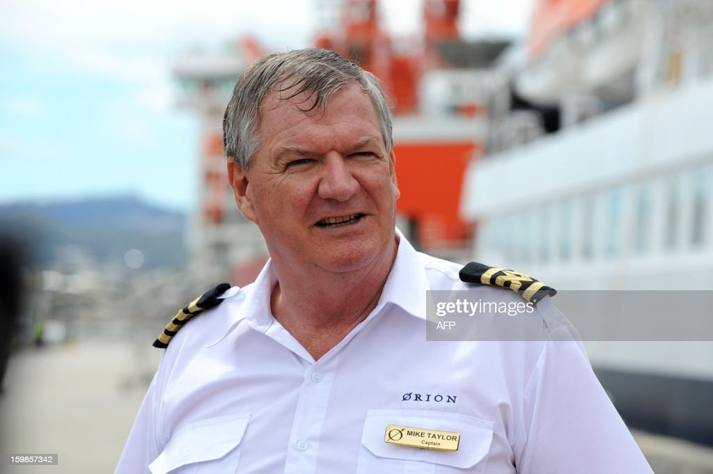 Captain Mike Taylor of the Antarctic cruise vessel the MV Orion, carrying rescued French sailor Alain Delord, speaks to the media after mooring at Macquarie dock in Hobart on January 22, 2013. A French sailor walked off the cruise ship that saved him after he spent three days adrift in a life-raft in the remote Southern Ocean, smiling and assisted by his rescuers. Alain Delord was marooned on a life-raft in mountainous seas about 500 nautical miles from southern Australia's Tasmania after his yacht was badly damaged in perilous weather during a solo round-the-world sailing attempt.