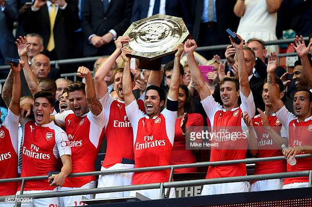Captain Mikel Arteta of Arsenal lifts the trophy after their 10 win in the FA Community Shield match between Chelsea and Arsenal at Wembley Stadium...
