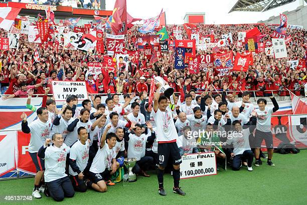Captain Mitsuo Ogasawara lifts the trophy after winning the JLeague Yamazaki Nabisco Cup final match between Kashima Antlers and Gamba Osaka at...